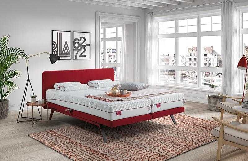 Dormitorio con una cama que tiene un colchón bodyprint pocket